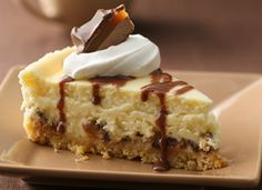 Cheese Cake used to scare me then I got a set of spring form pans for Christmas and have not looked back or batted an eye at a cheesecake.  I went looking for a candybar cheesecake after seeing one on the front of a book.