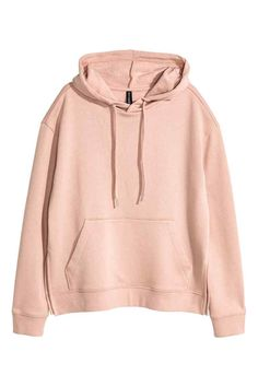 Hooded top: Top in soft sweatshirt fabric with a drawstring hood, kangaroo pocket at the front, slits in the sides and ribbing at the cuffs and hem. Soft brushed inside.