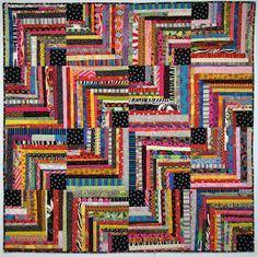 Wild ZigZag quilt by Wanda of Exuberant Color. she used different widths of strips to make these half log cabin blocks.