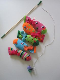 Fishing game with cute socks for fish. I'd put magnets in the toes, and one on the end of the pole.