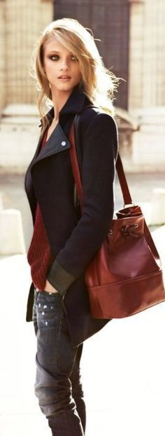 somehow love the slouchy brown leather bag with the tough black outfit