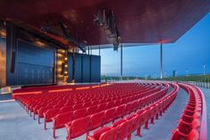 A huge roof clad in red-hued metal panels spans above this open-air theatre, which Canadian studio Atelier Paul Laurendeau has built on the waterfront of Trois-Rivières in Quebec.