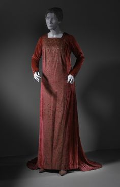 Woman's Evening Gown  Mariano (Jose Maria Bernardo) Fortuny (Spain, active Italy, 1871-1949)  Italy, circa 1919  Costumes; principal attire (entire body)  Silk velvet, pleated silk, and glass beads  Center back length: 62 1/2 in. (158.75 cm)  Gift of Lafe Speirs (AC1993.118.1)  Costume and Textiles