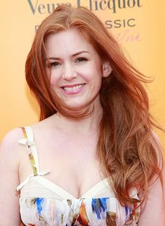 """Isla Fisher. """"The bubbly Aussie actress has great genes--and was born with that golden red shade."""" I love her hair. Darn it!"""