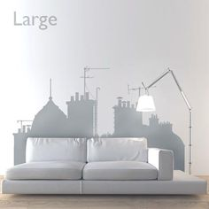 If you're looking for the perfect wall decals to elevate that blank wall from boring to sublime, then the classic cityscape silhouette in the Rooftops view D is the perfect choice.