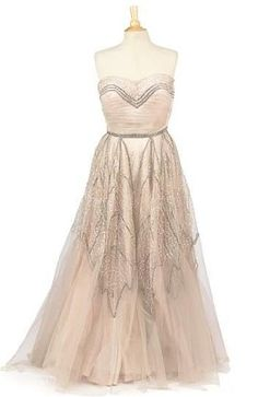 Strapless gown by Chanel.