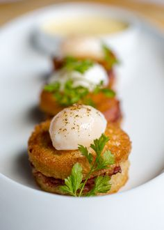 Quail eggs and brioche toast points with ham at Menton Restaurant, Boston