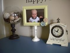 Get a candle stick and frame from a thrift store, paint, and then glue together and embellish