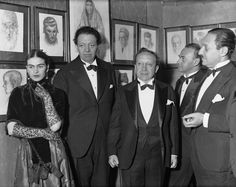 Frida Kahlo: At a dinner of the Menorah Artists and Writers' Committee in New York attended by Frida Kahlo and Diego Rivera, Rivera expressed outrage at being barred from completing a mural at Rockefeller Center because he included the image of communist leader Lenin in the painting. (Photo:  Bettmann/CORBIS)