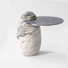 Cosmedin, 2016, Egg-shaped hand-carved Breccia Imperiale Stazzema marble block side table with a cast aluminium shelf. H 50 W 43 D 54 cm Edition of 10 | In the Basilica di Santa Maria in Cosmedin, Rome, lies a very fine Cosmatesque pavement, the form of which has been used as the mould for the aluminium tabletop in this side table. In further reference to the Basilica is the use of the Breccia Imperiale Stazzema marble which can be found throughout. #italiandesign #history #achillesalvagni…
