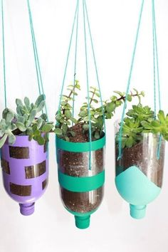 To Make Hanging Planters from Recycled Water Bottles DIY Hanging Recycled Water Bottle Planter Project – DIY Hanging Recycled Water Bottle Planter Project – Recycled Planters, Recycled Garden, Diy Planters, Planter Ideas, Recycled Bottles, Garden Planters, Tall Planters, Succulent Planters, Modern Planters