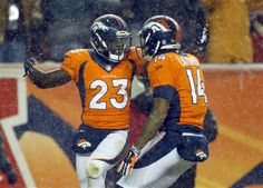 Denver Broncos running back Ronnie Hillman (23) celebrates his touchdown against the New England Patriots with wide receiver Cody Latimer (14) during the first half of an NFL football game, Sunday, Nov. 29, 2015, in Denver.