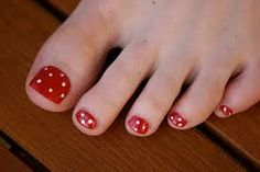 Red Polka Dot:  These one are so cute with their little white polka dots.  These could be done in any combination of colours ... for example, I have a Teal dress with an overshirt with a Peacock Feathers pattern (teal background with purple, navy blue, and golden brown colours).  I think I will use this pattern with teal toenails and purple polka dots ...