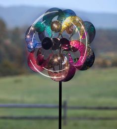 This Gala 4-Blade Solar Wind Spinner will knock your socks off! 4 solar panels and 4 independent blades make this spinner a stunner from any angle.  The solar panels absorb sunlight during the day to power the white LED lights at night!