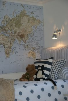 love the map & light above the bed, and the headboard, and the pillows. sigh...love the whole thing.