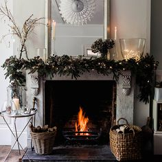Christmas greenery and fairy lights, The White Company.  For more Christmas decoration ideas, visit goodhousekeeping.co.uk/christmas