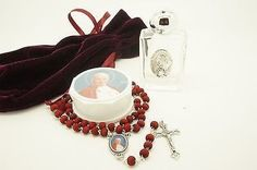 Saint John Paul II Rose Scented Rosary made of Wood and in Italy. It comes with: Saint John Paul II Holy Water Glass Bottle+ Velvet Wine color Bag. Ideal for a Baptism/Christening, Communion, Confirma
