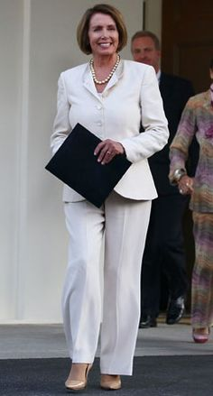An all white suit is hott any time of the year. Former Speaker Pelosi, takes the business suit to another level Nancy Pelosi Young, White Suits, Signature Look, Business Dresses, Look At You, Powerful Women, Boss Lady, Business Women, Amazing Women