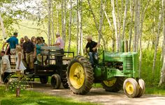 Wagon rides out to the woodland wedding setting add extra charm.   Dixon's Apple Orchard and Wedding Venue, Cadott, Wis.