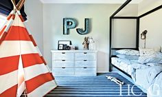 Nautical-inspired bedroom with striped tee pee and marquee letters