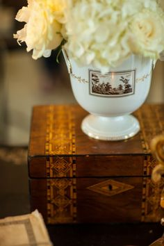 Step out of the box when displaying fresh flowers.  Ginori cache pot atop an antique Turnbridge inlaid box.