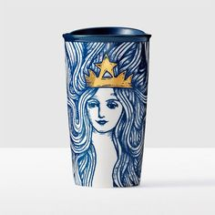 The+gold-crowned+Siren+appears+in+a+wood-etched+style+with+enchanting+flowing+hair+in+a+beautiful+Pacific+blue.