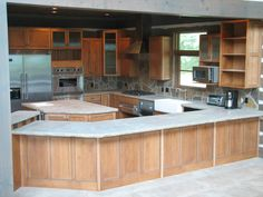 I love everything about this kitchen, but my favorite part is the shape. Square or rectangle kitchens bore me...