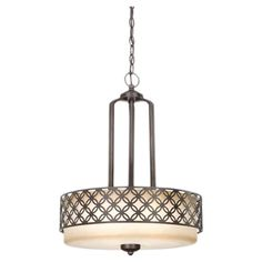 New Foyer Light Pendant in patina bronze with a chestnut glass shade and geometric openwork motif.