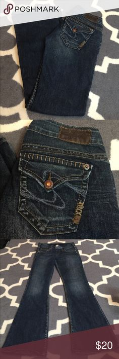 Silver jeans Tuesday Flap flare 26x31 Darker wash; great detailing. No rips or stains. Zipper flows smoothly. Little wear to ends; not terrible. Front rise 7 inches. I get 29.2 inches when I measure inseam. Bundling is fun; check out my other items! No price talk in comments. No trades or holds. NO SPAM. Silver Jeans Jeans Flare & Wide Leg