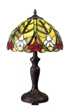 This traditional Tiffany table lamp is brought to you by Z-Lite. Great for living room bedroom offices and more. Like this lamp find it and others like it here.