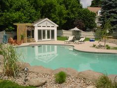 Pool bordered faux boulders, real boulders and decorative stone.