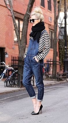 Slouchy denim overalls, striped shirt, and black heels.