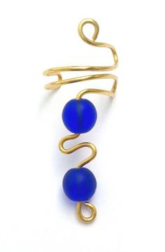 Hey, I found this really awesome Etsy listing at https://www.etsy.com/listing/239218919/cobalt-blue-and-gold-wire-ear-cuff-blue