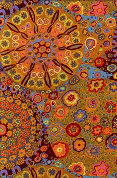"""Kaffe Fassett fabric -""""Millefiore"""" the photo does not reproduce the colors accurately; the rusty, tan, pale yellow and red/orange tones are complimented with  lavender, eggplant; tiny touches of blue, a little celadon, aqua and orchid"""