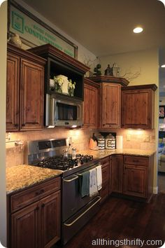 cottage style kitchen 3: All Things Thrifty ~ Cabinets love the stove
