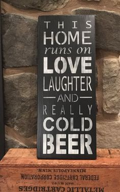 THIS HOME RUNS ON LOVE LAUGHTER AND REALLY COLD BEER  This sign is hand-made using select pine, acrylic paints, and a nontoxic sealant. It will arrive ready to hang. Indoor use only. Production time is 5-7 days. If you need it sooner please contact me prior to purchase to see what I can do. This sign measures approximately 7 1/4 by 18 inches. Since this is a made-to-order sign please note that slight variations in the measurements may occur. No two signs are the exact same. Please choose...