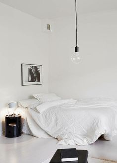 all white bedroom with minimal decor