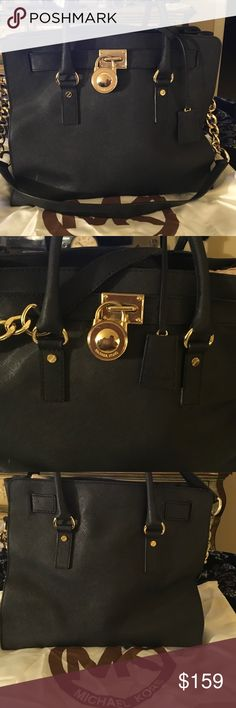 MIchael KORS Black Hamilton Saffiano HAndbag Large MKHamilton authentic BLACK Saffiano leather w/ gold tone hardware.  IN excellent condition w/ 1 small scratch (see least photo). Interior is neat & clean w/ original MK logo fabric, has keyfob,multiple interior convenient pockets. COmes w original MK dust bag. Michael Kors Bags Totes
