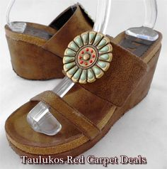 Funky and unique wedge heel sandals with bohemian southwestern/ native design!  ART EFFECTS #Bronze #LEATHER #Turquoise Beads Wedge #Heels SANDALS #ArtEffects #Platforms #Wedges Women's shoes   Southwestern Native American-inspired wedge sandals from ART EFFECT. Bronze-finished leather and cork. Turquoise and red glass beads formed into a floral shape on a metal medallion on vamp.   #VINTAGE #RETRO #INDIE #HIPPIE #BOHO #HIPSTER