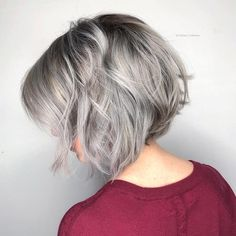 Grey Aveda hair color toes the line between edgy and fanciful. We love this silver angled bob by Aveda Artists Leah and Tatiana at Pyure Aveda Salon.