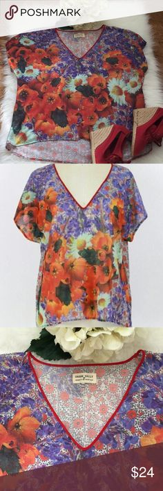 Anthroplogie/Dream Daily Floral Tee Cute tee by Dream Daily from Anthroplogie in a colorful floral design of reds, purple, white, green and yellow. Red piping around v neck collar. Hi low hem, soft and flowing! Excellent like new condition. Anthropologie red espadrille wedges also available from my closet. Anthropologie Tops Tees - Short Sleeve