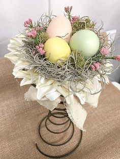 Spring Table Centerpiece Art With Painted Eggs And Other Decorative Items
