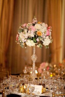 but use wild flowers or something else. tall centerpieces--skinny vase like this?