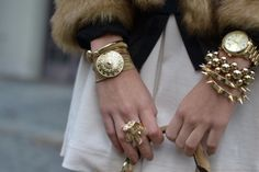 Seems watches are making a comeback. Loving the watch mixed w/ bangles/bracelets look.