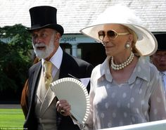 Princess Michael of Kent kept her cool in a floaty polka dot outfit and carried a fan...