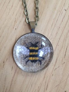 Bee cross stitch pendant necklace
