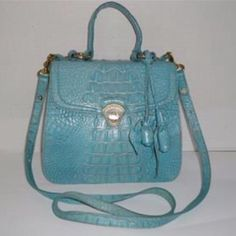 BRAHMIN MELBOURNE TURQUOISE MESSENGER SATCHEL BRAHMIN OLIVIA ROSE TAFFETA MELBOURNE TURQUOISE TEAL LEATHER MESSENGER HANDBAG​  Material(s):  LEATHER  Condition: GOOD SHOWS LIGHT WEAR TO THE BOTTOM CORNERS & SIDES, SMALL MARKS/PEN MARKS INSIDE  Color(s): TURQUOISE TEAL OR AQUA  Hardware Tone:  GOLD (please note gold tone is wearing off turn lock quite a bit and looks silverish)  Number of Pockets:  Exterior:  1 Interior:  5 Lined (Y/N):  Y  Adjustable Strap (Y/N):  Y  Measurements:  Width…