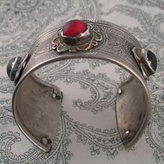 Old silver and enamel bracelet set with colored glass stones from Algeria. estimated to be circa 75 years old.