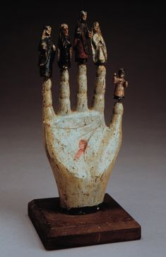 Hand icon with saints...