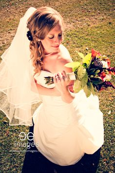 Montana Wedding-Great shot of bride and flowers.  Fall wedding.